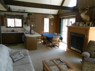 Kitchen, living room, and dining room at Snowman Cabin.