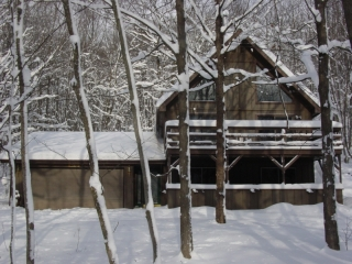 Winter view of Snowman Cabin in Gaylord Michigan.